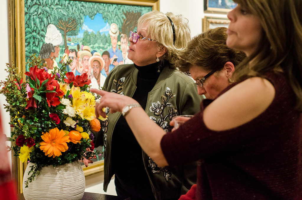 . Guests enjoy  Fitchburg Art Museum\'s 19th Annual Art in Bloom on Friday, March 31, 2017. SENTINEL & ENTERPRISE / Ashley Green