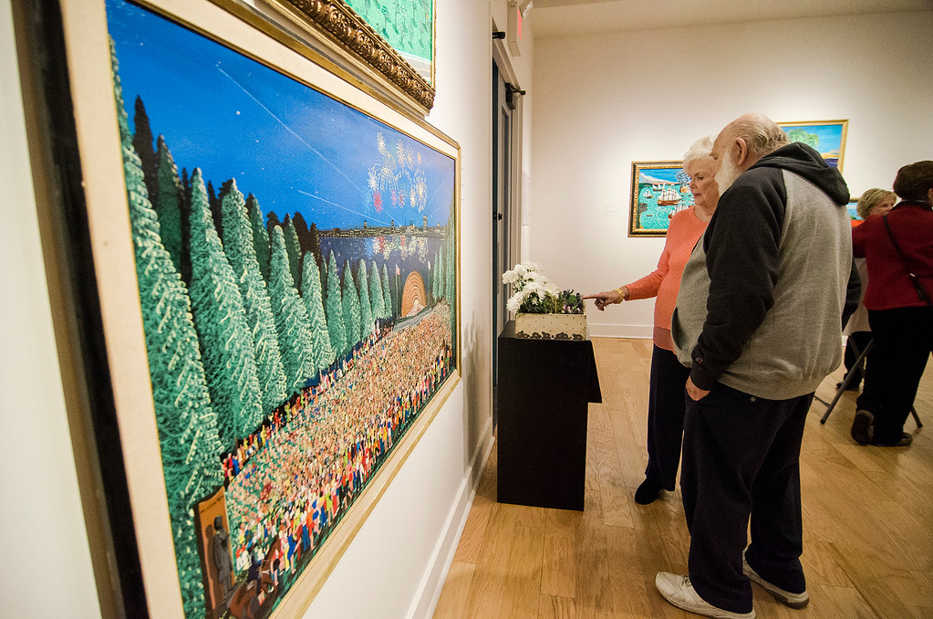 . Carleen DeBlois and Bud Goguen take a closer look at the artwork during Fitchburg Art Museum\'s 19th Annual Art in Bloom on Friday, March 31, 2017. SENTINEL & ENTERPRISE / Ashley Green