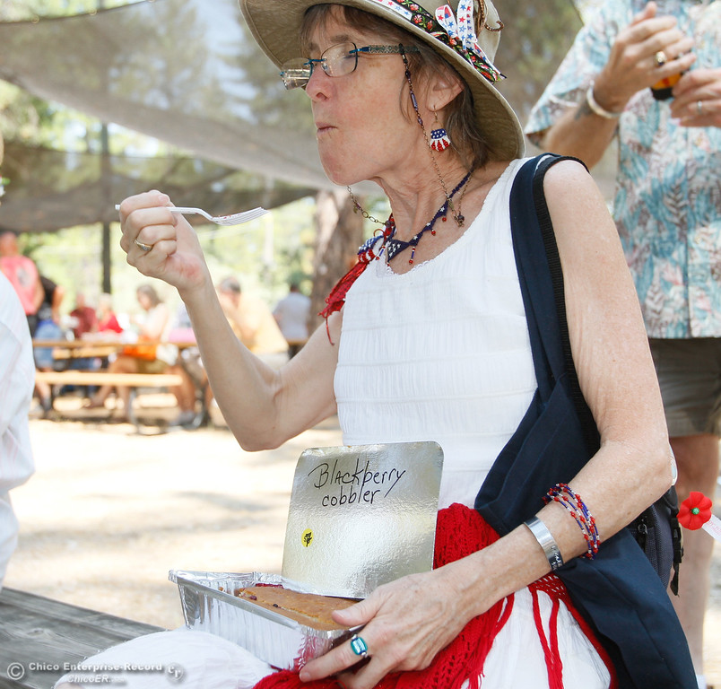 . Marci Trimlett enjoys some blackberry cobbler and live music during the 19th annual  Berry Creek Berry Festival Saturday August 12, 2017 in Berry Creek, California. (Emily Bertolino -- Enterprise- Record)