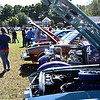 Locals check out all sorts of cool cars at the Charity Car Show on Pepperells Town Field hosted by 1A Auto. SUN/David H. Brow