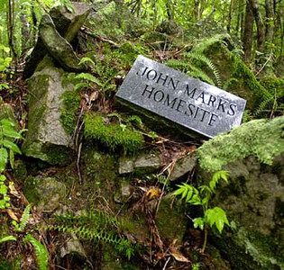 This marker was placed at the site of the John Marks plantation identifying the location of the Marks home of 1780's. The pile of stones are from the original foundation and chimney of the Marks' home.