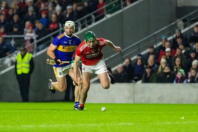 Cork's Robbie O' Flynn gathers the ball ahead of Tipperary's Padraic Maher