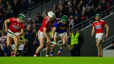 Tipperary's Paddy Cadell and Cork's Alan Cadogan, Patrick Horgan and Robbie O'Flynn