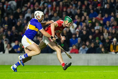 Cork's Robbie O' Flynn is challanged by Tipperary's Sean O'Brien