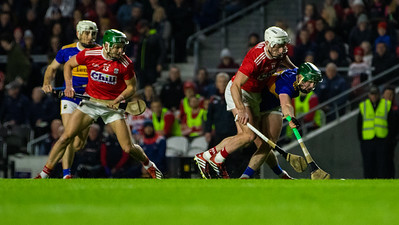 Tipperary's Paddy Cadell is put under pressure from Cork's Patrick Horgan