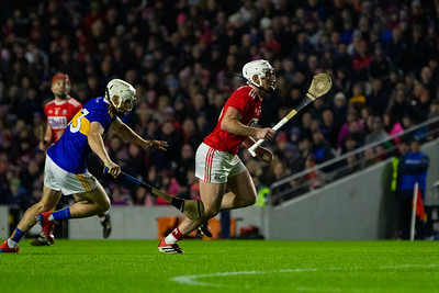Cork's Patrick Horgan races towards goal followed by Tipperary's Joe O'Dwyer