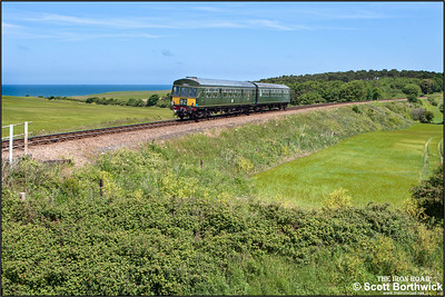 51192/56352 accelerate away from Bridge 303 between Weybourne & Sheringham whilst forming 2C09 1203 Holt-Sheringham on 11/06/2015. (Photo taken with camera mounted on a pole & remotely triggered)