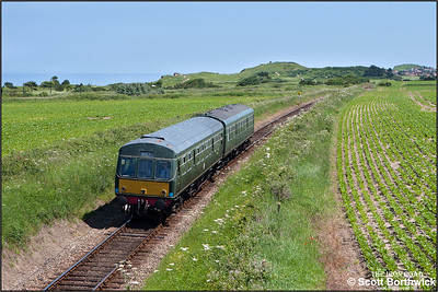 51192/56062 approach Dead Man's Hill whilst working the 1245 Sheringham-Holt service on 12/06/2014.