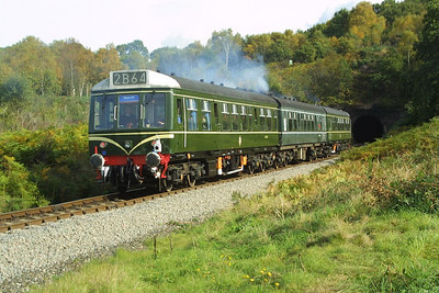 52064 brings up the rear of the 1250 Arley-Kidderminster shuttle service as it is about to enter Foley Park Tunnel on 04/10/2002.