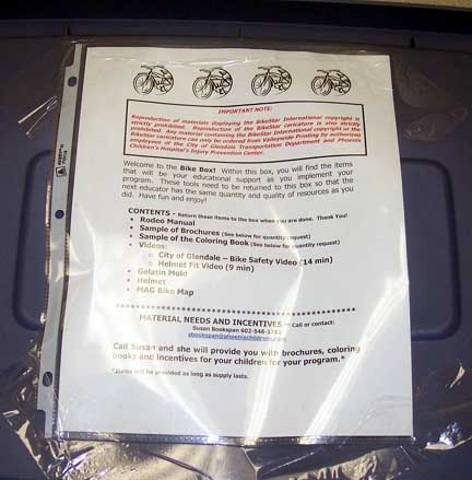 """In Glendale, Arizona, $77,600 was used to assemble and distribute safety and educational materials to all local elementary schools, libraries, and youth organizations. The comprehensive bicycle education program includes materials for teachers and youth leaders to teach 8-13 year olds about bicycle safety. These """"Bike Boxes"""" included a step-by-step trainer's manual, instructional equipment, safety videos, a bicycle helmet, children's worksheets, and more. The project was sponsored by the City of Glendale and the project received the Golden Spoke Award for the 2004 Valley Metro Clear Air Campaign."""