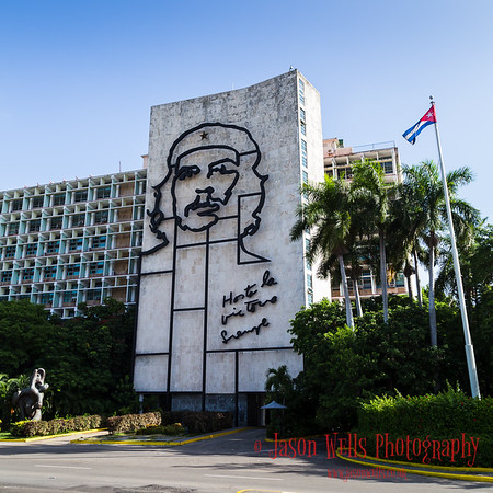 Cuban flag next to Che's sculpture at Revolution Square