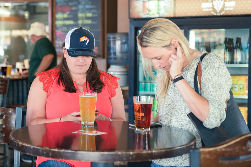 Ashleigh Fox | The Sheridan Press&lt;<br /> <br /> Sheridan Press Publisher Kristen Czaban, left, and Darcy Sengewald download the My Bighorns app during the Happy Hour for 20 Under 40 and app launch at Black Tooth Brewing Company Monday, June 17, 2019.