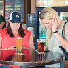 Ashleigh Fox | The Sheridan Press<  Sheridan Press Publisher Kristen Czaban, left, and Darcy Sengewald download the My Bighorns app during the Happy Hour for 20 Under 40 and app launch at Black Tooth Brewing Company Monday, June 17, 2019.