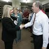 Senator Coonan congratulates David Font as 2AAA chair Jean Haste looks on