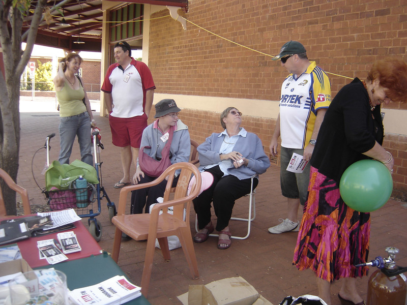 One local lady chats to Scott Chambers, while Catherine and Julie Velthuis tell a potential member all about 2AAA