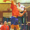 cnc/langara men volleyball dave milne jan 21 00 CNC middle Will Lanenga jumps for the spike, power Randy Danilec watches.
