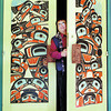 UNBC native art doors in thursday dave milne april 27 00 Native artist Ron Sebatian looks out between the carved doors to the UNBC Senate Chamber which he created.  He carved the panels over three months in  yellow cedar. The figures represent human beings, at the bottom, and animals representing First Nation Clans like the bear and cubs, raven,  frog, wolf, crow and cariboo.The handles are carved to represent the Frog Clan. The figures on the left door are female and those on the right, male.