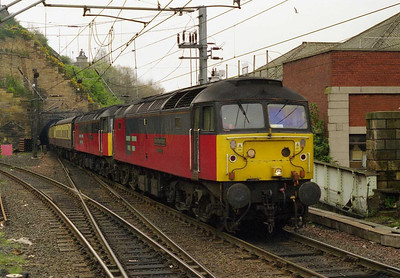 With 47793 d.i.t, 47734 'Crewe Diesel Depot' arrives at Edinburgh with 1Z91 0720 'rugby' charter from Castleford. 'Saint Augustine' had failed at Newcastle, where '734 had been attached to work the train forward (29/04/2000)