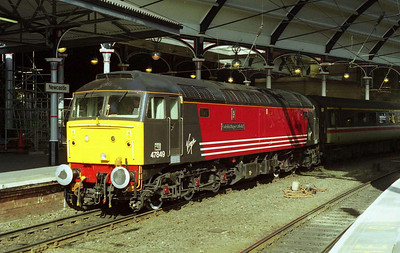 Still in immaculate condition following its recent naming ceremony, 47849 'Cadeirlan Bangor Cathedral' is pictured at Newcastle after working the same train the following Sunday (19/03/2000)
