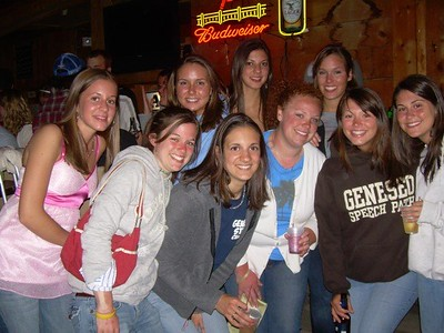 """This picture of us """"Moe Girls"""" or so we called ourselves was taken at The Idle bar on the night of our graduation day, Saturday, May 12th 2007. We had all just walked accross the stage and enjoyed the wonderful sunshine...and were enjoying our last day and night as Geneseo college students. Hard to believe we all met while living in Monroe Hall freshman year, and now here we were...senior year was over and after four amazing years, we were now graduates and alumni!  People in picture, from left to right back row: Meghan McCarthy, Lindsay Rokos, Beth Copani, Connie Kaplin Left to right front row: Katie Howard, Jamie Fragnito, Meghan Scheib, Allie Murray, and Vicki Barone"""