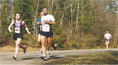 2001 Merville 15K - Kathy Rung and Bob Cook, with Nancy Baxendale lurking in the background
