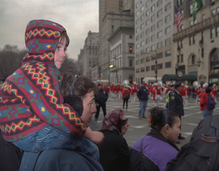 Benjamin on Chantal's shoulders, watching the St. Patrick's Day parade