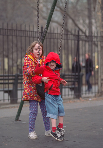 Isabel and Benjamin on the swings, Washington Square Park