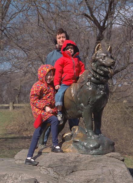 Isabel, Chantal, and Benjamin at the Balto statue, Central Park