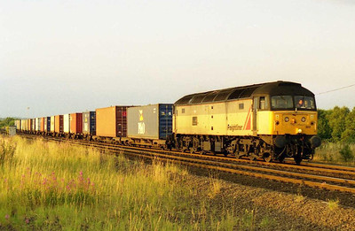 On a perfect summer evening 47303 'Freightliner Cleveland' approaches Normanton with 4L64 2010 Stourton - Tilbury Intermodal (27/07/2001)