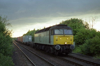 In fading light, 47295 rumbles towards Methley with 4L64 2010 Leeds - Tilbury Intermodal (??/07/2001)