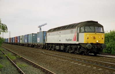 47367 departs from the Stourton Freightliner Terminal with 4L64 2010 Leeds - Tilbury Intermodal service (20/07/2001)