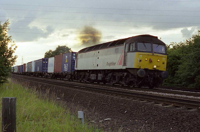 47367 opens up after clearing Stourton Junction with the 4L64 2010 Leeds - Tilbury Intermodal (24/07/2001)