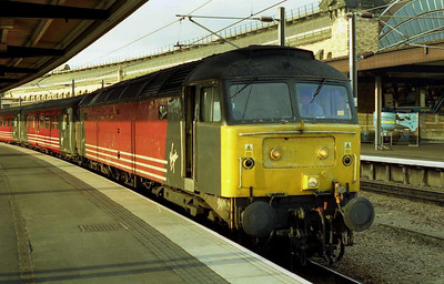 With traces of a recent graffiti attack still visible on its bodyside, 47844 waits at York with the SuO 1M59 2022 to Birmingham New Street (01/07/2001)