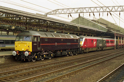 One of pair of locos dedicated to the Royal Train, 47799 'Prince Henry' is pictured on arrival at Crewe with the SuO 1A02 0358 Holyhead - Euston. Although booked to come off at Stafford, the '47' worked the train through to London on this occasion. Oops... (29/07/2001)
