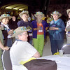 Wed 10, 2002. Philadelphia, PA. Photos by Mike Levin. - Global Education and Advocacy. Popcorn Reception. Delgates from Southwestern Texas enjoy themselves and display their hats of course.