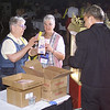 Wed 10, 2002. Philadelphia, PA. Photos by Mike Levin. - Global Education and Advocacy. Popcorn Reception. Faye Childres  and Barbara Bloomer of Minnesota get their free popcorn from the popcorn guy, Joel Zimmerman.