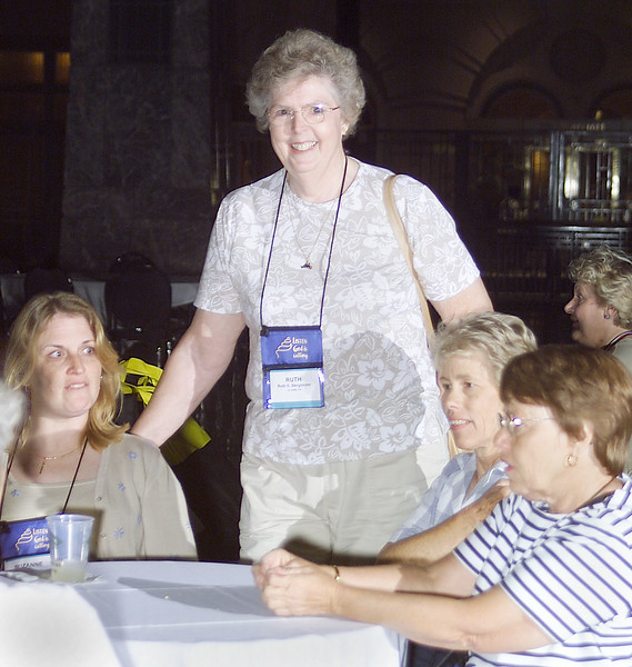 Wed 10, 2002. Philadelphia, PA. Photos by Mike Levin. - Global Education and Advocacy. Popcorn Reception. Delegate Ruth Begstrom of LaJolla, CA (standing) has a captive audience.