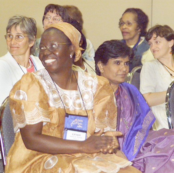 Thursday, July 11, 2002. Philadelphia, PA. Photos by Mike Levin. - Global Education and Advocacy. Esther Thomas from Liberia and Subhashini Bondu from India enjoy a moment of laughter.