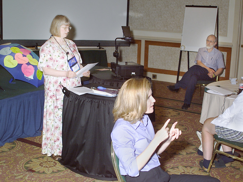 Thursday, July 11, 2002. Philadelphia, PA. Photos by Mike Levin.- Perspectives for the Differently-Abled- Marriott hotel,  Salon K & L. - (left - right) Laura Rorem from Juneau, Alaska speak about Mental Illness and brain disorders. Kristen Parkhouse translates into sign language while Larry Rorem looks on.
