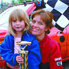 PGARA mini  stock winner in monday dave milne july 27 02 Driver Lisa Angove poses with tropy girl Alison Stedford, 5 and her trophy for winning the A heat mini stock race saturday night at PGARA.