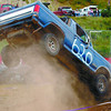 PGARA tuff truck race in monday dave milne aug 11 02 Jamie Crawford rams his truck into an obstacle during ther Tuff Truck race at PGARA Sunday. The truck died and he finished this heat on foot.