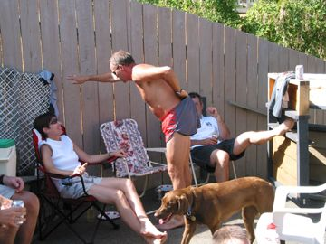 2002 Corn Roast - Anita seems rather amused by Bill's antics