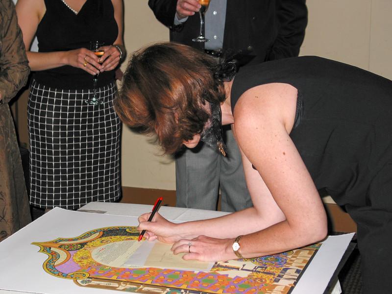 Caroline signing the Katubah