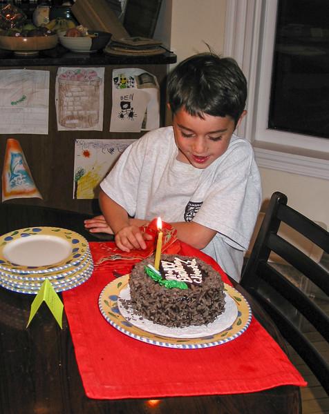 Benjamin admiring cake