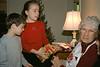Benjamin and Isabel bringing presents to Grandma Dorothy