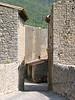 Forbidding stone walls entering the village