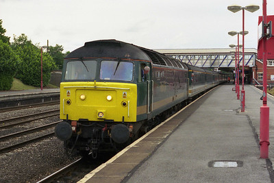 47816 departs Newbury with 1A45. Note the peculiar shade of yellow applies to the cab front (21/05/2002)