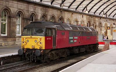 47776 'Respected' relaxes in Platform 12 at Newcastle whilst on 'Thunderbird' duty for GNER (04/08/2002)