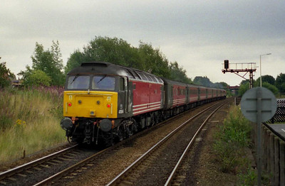 ...but I was capturing a moment of history. 47854 brings up the rear again as '805 heads north into the sunset. The pair returned from Edinburgh via the WCML the next day on '1O12' (11/08/2002)