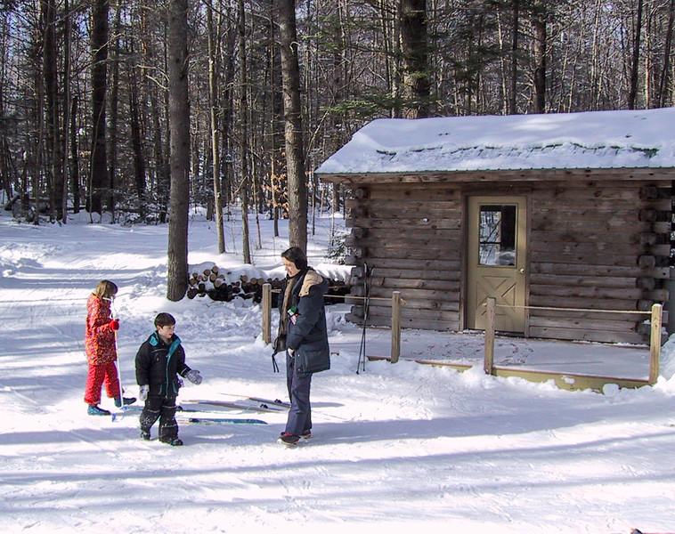 Isabel, Benjamin, and Chantal at the warming hut